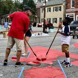 Mayor Chris Cerino Painting the Black Lives Matter Street Mural with a Young Boy