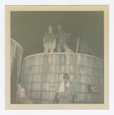 Four VITA Foods Employees Pose By Tank