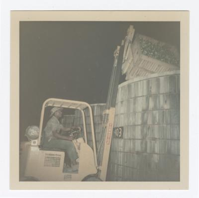Robert Moore Operates Forklift at Night