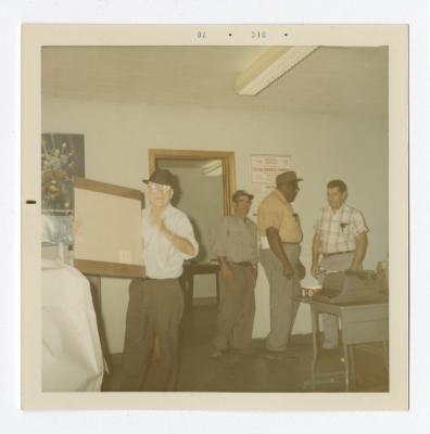 Group of Men in an Administrative Office at VITA Foods