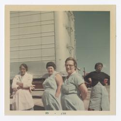 Female VITA Foods employees posing outside
