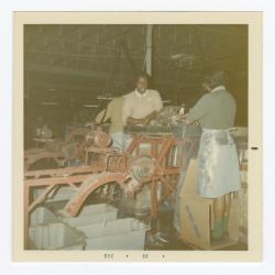 Doris Green and Geraldine Brooks at the VITA Foods fish processing machine
