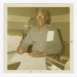 R. Henry Ford completing VITA Foods paperwork