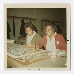 Dorothy Kennard Hutchins and Lena Clark working on a puzzle during their work break at VITA Foods