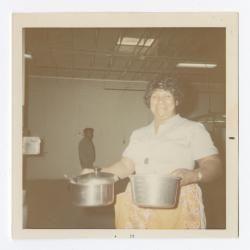 VITA Foods employee holding pots