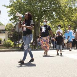 Woman Leading March with Bullhorn