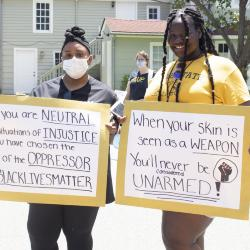Two Women with Protest Signs
